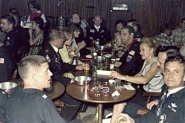 O Club probably Feb. 68. Left to right: Ben Fhurman, 4 unk., Rog Ingvalson, 3 unk., Harry Paddon, girl unk., Jack Brooks, Buddy Barner.