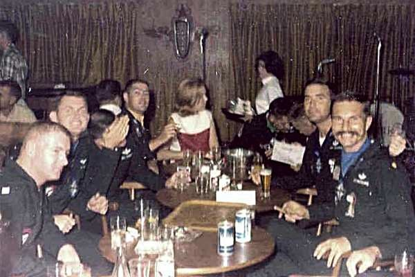 More fun in the club. Left to right: Ed Hartman, Bill Thomas, Bill Shunney (hand), Dave Igleman, girl unk, 2 unk, Gary Durkee, Sam Armstrong.