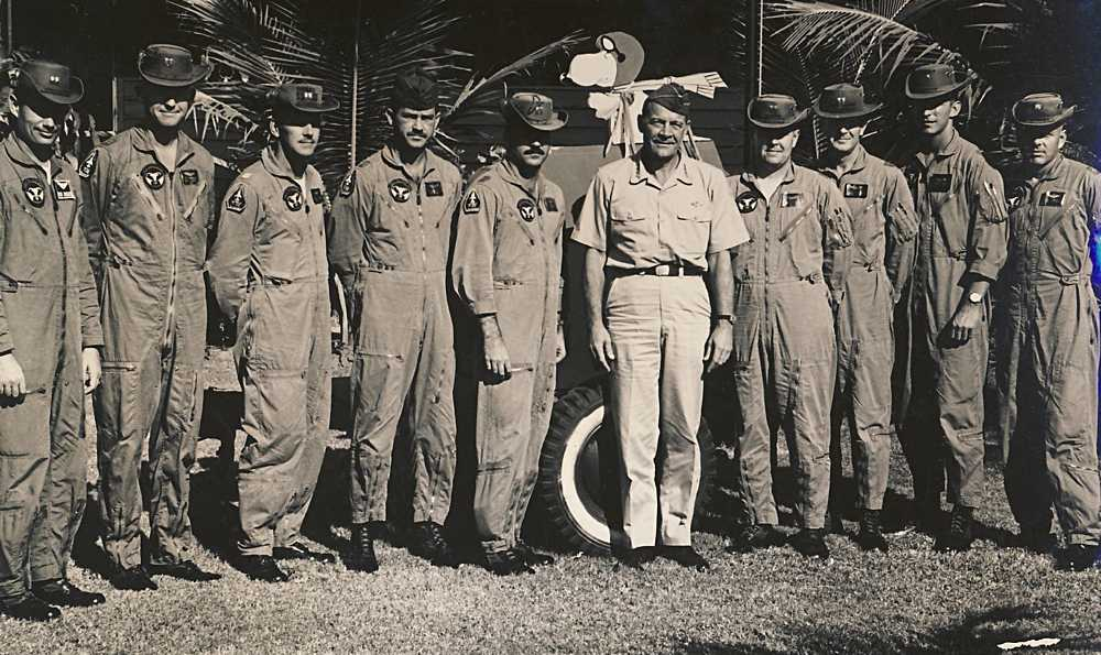 General Joseph J. Nazzaro (center), PACAF CINC, with 34th pilots (from left): Captains Robert M. Howard Jr., John H. Wambough Jr., James V. Barr, Olin K. Everett, Ralph E. Durnbaugh, Oral L. Bell, Darrell J. Ahrens, First Lieutenant David S. Hartman Jr. and Major Richard E. White. (USAF Photo)