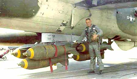 A standard load of 750 pound bombs with Monty Pharmer giving them a check in 1968.