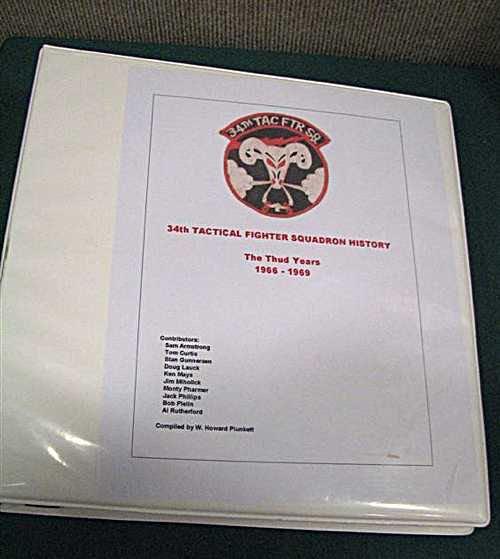 Howard Plunkett's squadron history binder.