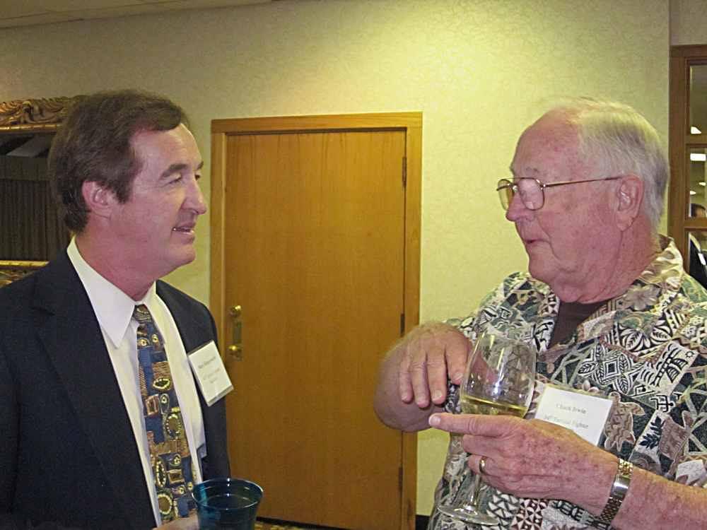 Mark Klingensmith listens to Chuck Irwin.