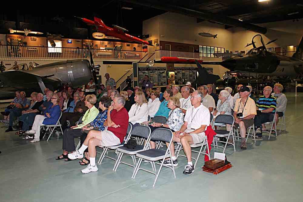 Seated near the F-105 on display.