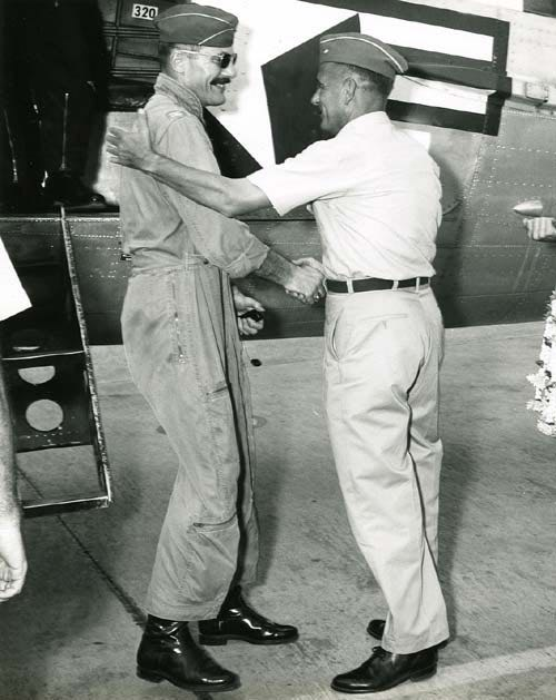 General William Chairsell greets Colonel Robin Olds.